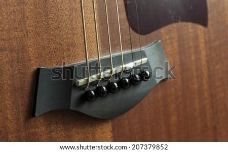 wood bridge acoustic guitar - stock photo