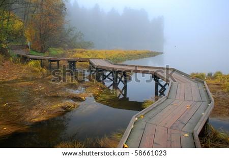 Wood Bridge in Fog - stock photo