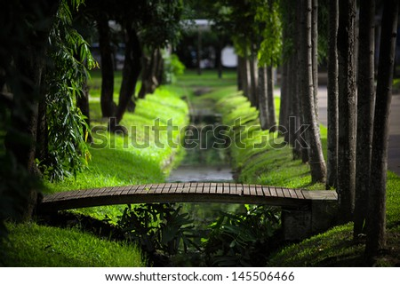 wood bridge in park - stock photo
