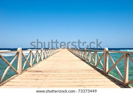 Wood bridge on the sea (Egypt excursion) - stock photo