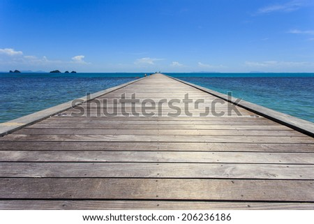 Wood bridge to the sea in Koh Samui, Thailand - stock photo
