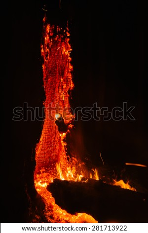 Wood burning during a forest fire - like a volcanic eruption - stock photo
