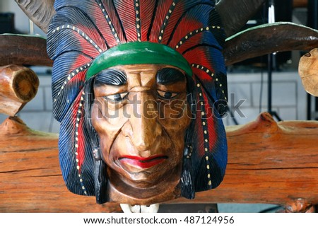 wood carved of indian chief head isolated on white background