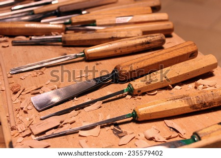 Wood carver's set of Wood carving tools on wooden table - stock photo