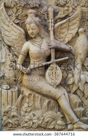 Wood carving Buddhist temple door public places of Buddhist worship. - stock photo