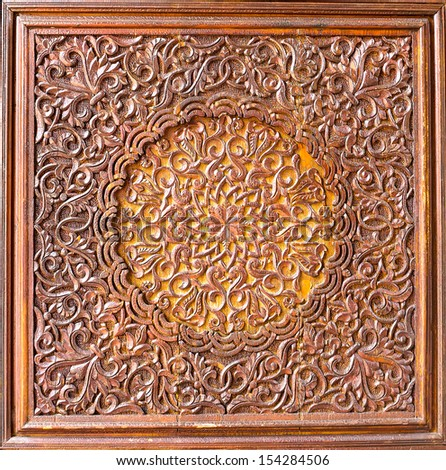 Wood carving of flower motif  - stock photo