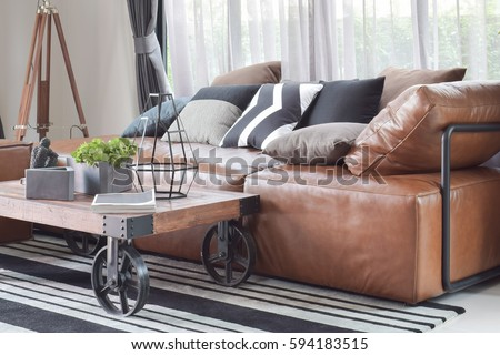 Charmant Wood Center Table With Wheel And Light Brown Leather Sofa In Industrial  Style Decoration
