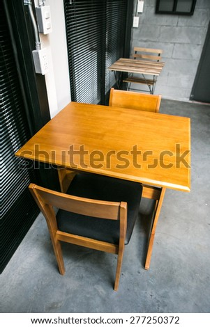 wood chair and table, furniture style in coffee shop - stock photo