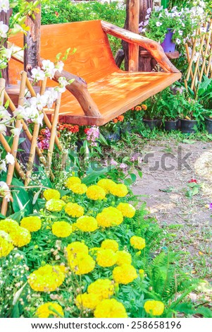 Wood chair in the flowers garden. Flowers in the garden.  - stock photo