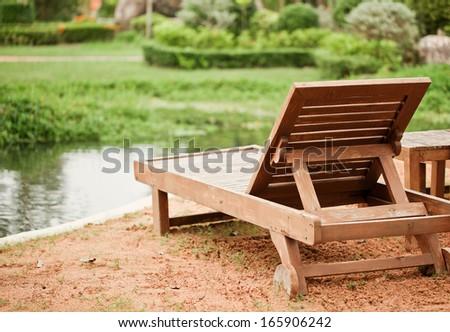 Wood chair on river beach in Pattaya, Thailand - stock photo
