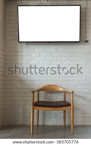 Wood chair with brick wall and television screen, Decorate Interior concept