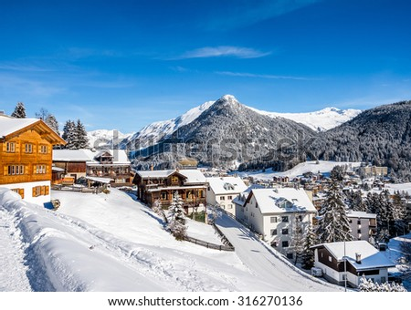 Wood chalet  over scenery of winter  resort Davos, Switzerland. - stock photo
