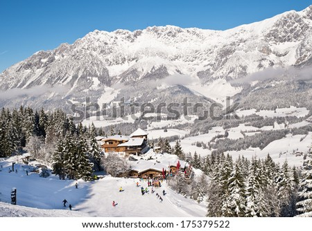 Wood chalet over snow mountains in Austrian Alpes. - stock photo