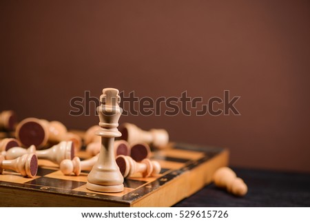 wood chess pieces on board game. brown vintage background