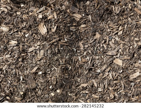 Wood chip mixed into soil. - stock photo