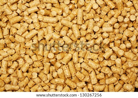 wood chip pellets a renewable source of energy becoming popular as a green environmentally friendly fuel for stoves which provide household heating - stock photo