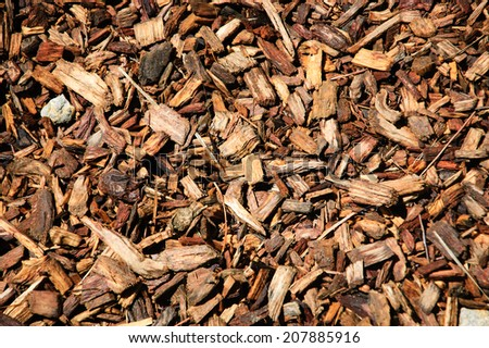 Wood chips for landscaping in the gardens. Ecological background. - stock photo