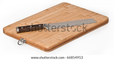 Wood chopping board with knife on a seamless white background
