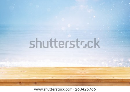 wood deck in front of abstract sea landscape. ready for product display. textured image  - stock photo