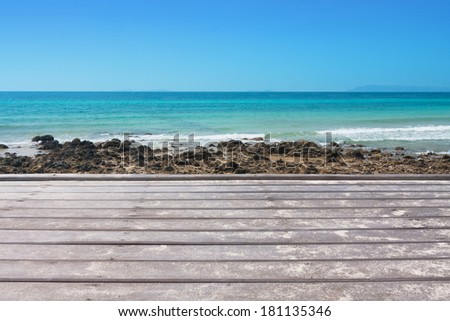 wood deck on the beach of koh larn island ,thailand. - stock photo