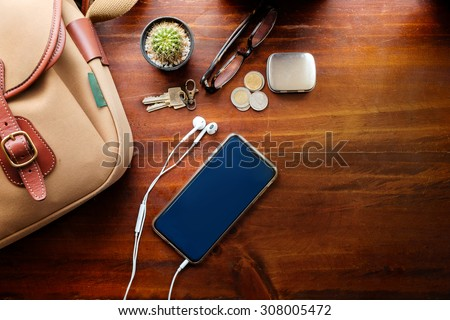 Wood desk with smartphone, top view - stock photo