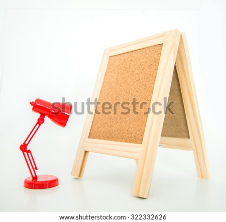 Wood display corkboard with alarm clock on white background - stock photo