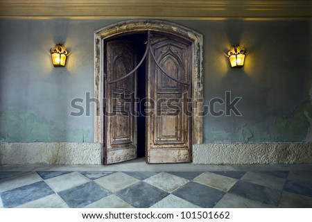 wood door and two lantern on a old wall. - stock photo