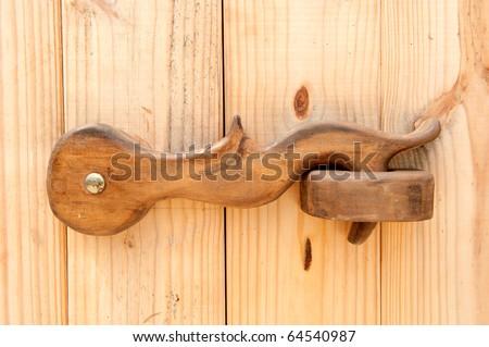 Wood Door latch - stock photo