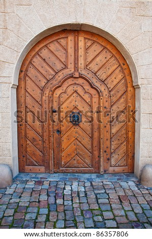 Wood door with cobblestone road. Detail from the streets of Prague. - stock photo