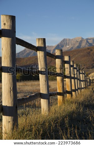 Wood fence line autumn foliage on mountains