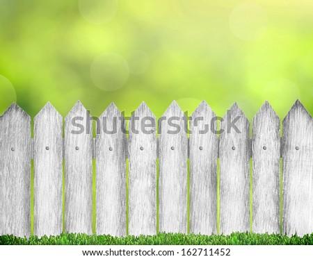 wood fence over bokeh - stock photo