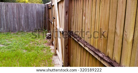 Wood fence with gate in yard - stock photo