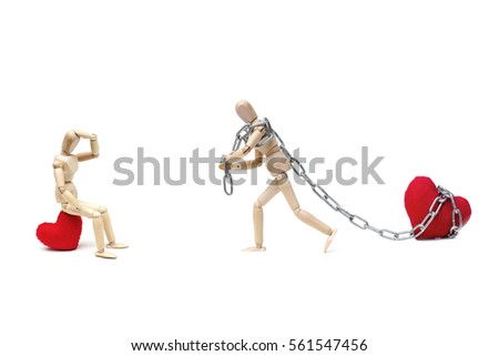 Wood Figure Mannequin using a chain to pull a big red heart for his lover