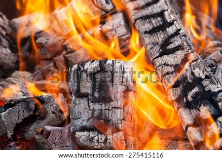 Wood fire with ash, Closeup - stock photo