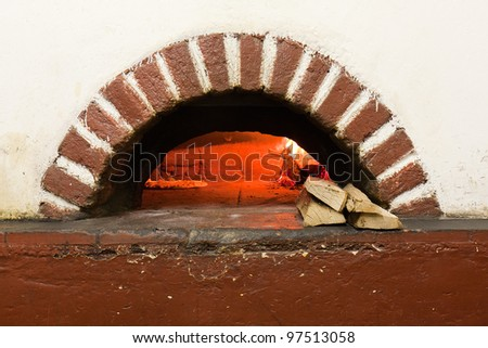 Wood-fired pizza oven - stock photo