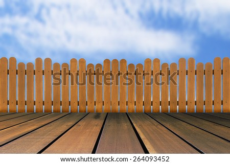 wood floor and wooden fence on a blue sky background - stock photo