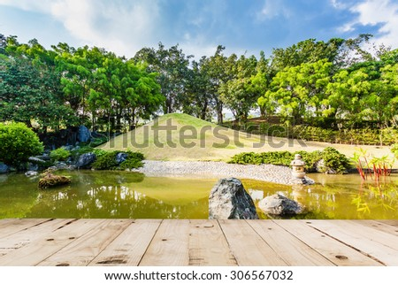 Wood floor on Pond and Water Landscape in Japanese Garden - stock photo