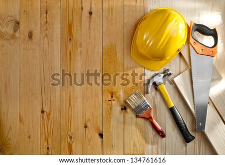 wood floor with a brush, tools and helmet - stock photo