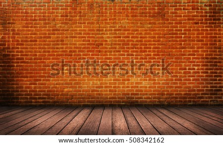 Wood floor with red brick wall background