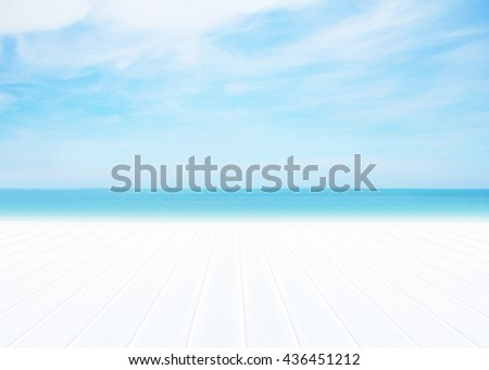 Wood floor with white blue surfing wave background. Blue water and sky bright. Nature wallpaper blur of sea daytime. Focus to wooden in the foreground. Timber pattern texture stage. Cool atmosphere. - stock photo