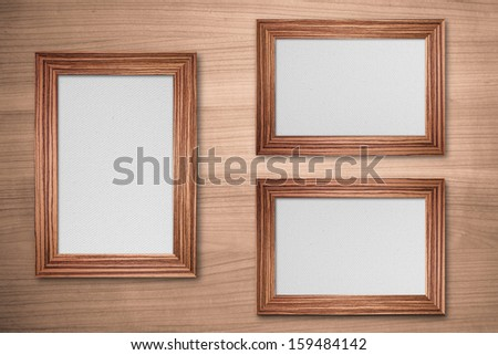 Wood frame with canvas on wood background - stock photo