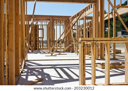 Wood frames for a house are put up and supported temporary.  - stock photo