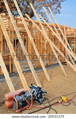 Wood framing on a new residential construction project - stock photo