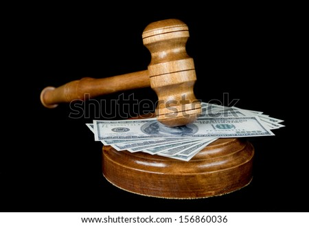 Wood gave,  soundblock and bank notes on a black background - stock photo
