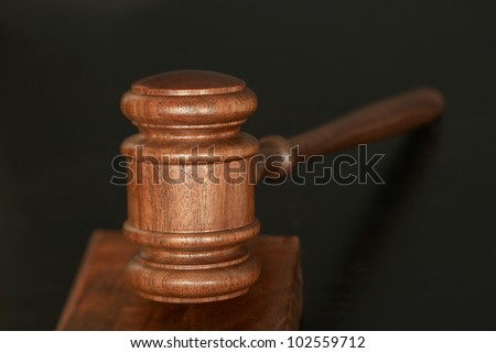 Wood gavel on dark background - stock photo