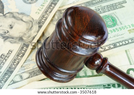 Wood gavel over some bank notes - stock photo