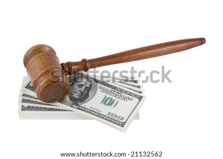 Wood gavel over some bank notes isolated - stock photo