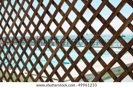 Wood grating with the sea view.