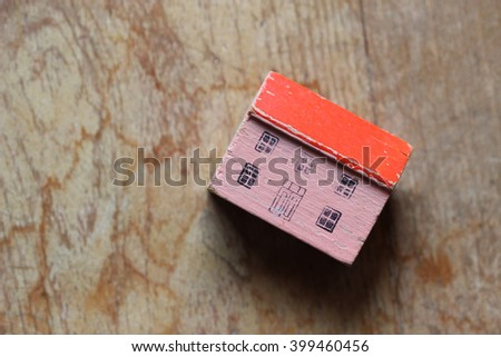 Wood house with peeling paint and age against open wood grain background for copy - stock photo