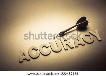 Wood letters of Accuracy word with dart - stock photo